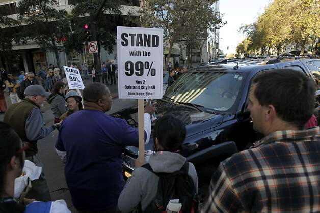 Occupy Oakland protesters block a car trying to turn onto Broadway from 14th Street duirng a general strike in Oakland, Calif. on Wednesday, Nov. 3, 2011. Photo: Paul Chinn, The Chronicle