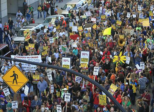 A crowd of about 3,000 Occupy Oakland protesters march on Clay Street to the Elihu Harris State Building during the movement's general strike in Oakland, Calif. on Wednesday, Nov. 3, 2011. Photo: Paul Chinn, The Chronicle