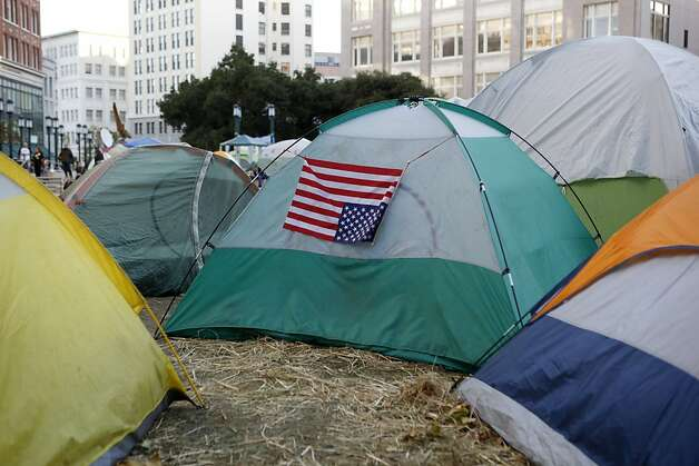 A upside-down American flag, a signal of distress, hangs on a tent at the Occupy Oakland campsite in the morning of Wednesday, November 2, 2011 in Oakland, Calif. Photo: Beck Diefenbach, Special To The Chronicle
