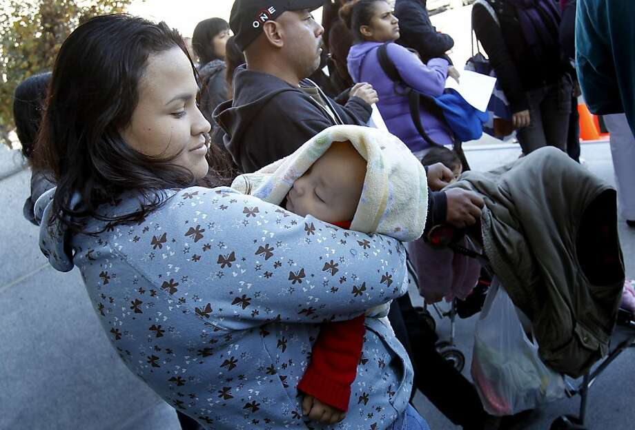 Homeless mother Daniela Mercado held her son Roberto during the rally. A determined group of homeless families and their supporters held a rally at San Francisco, Calif. City Hall and then demanded a meeting with Mayor Ed Lee about the homeless family predicament in the city. Photo: Brant Ward, The Chronicle