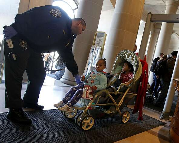 San Francisco Sheriff personnel helped some homeless children through the metal detector area. They are the son and daughter of Geneva Carter. A determined group of homeless families and their supporters held a rally at San Francisco, Calif. City Hall and then demanded a meeting with Mayor Ed Lee about the homeless family predicament in the city. Photo: Brant Ward, The Chronicle