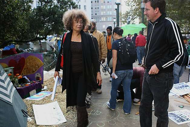 Angela Davis (left) visits the plaza during the General Assembly of Occupy Oakland in Oakland, Calif., on Wednesday, November 2, 2011. Photo: Liz Hafalia, The Chronicle