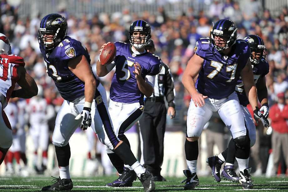 BALTIMORE - OCTOBER 30:  Joe Flacco #5 of the Baltimore Ravens looks for a receiver against the Arizona Cardinals at M&T Bank Stadium on October 30. 2011 in Baltimore, Maryland. The Ravens defeated the Cardinals 30-27. (Photo by Larry French/Getty Images) Photo: Larry French, Getty Images