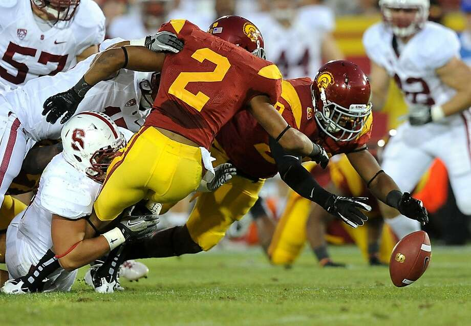 Southern California's Robert Woods (2) fumbles the ball on a kickoff return, but the ball is recovered by teammate Jawanza Starling against Stanford at the Los Angeles Coliseum on Saturday, Octob er 29, 2011. (Wally Skalij/Los Angeles Times/MCT) Photo: Wally Skalij, MCT