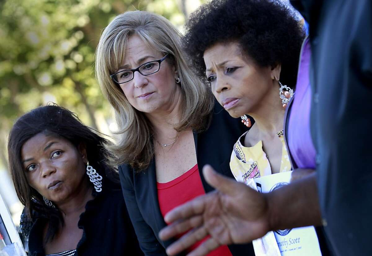 District Attorney candidate Sharmin Bock (center) stood between the relatives of shooting victims, Paulette Brown (left) and Mattie Scott (right). District Attorney candidate Sharmin Bock appeared at a press conference with relatives of murder victims whose killings remain unsolved Thursday October 27, 2011.