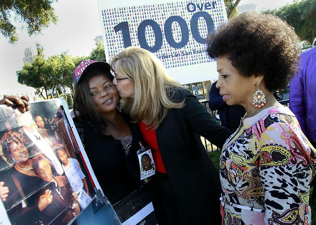 Paulette Brown (left), whose sons murder remains unsolved, was embraced by District Attorney candidate Sharmin Bock as Mattie Scott (right), whose son and nephews murders remain unsolved, looked on. District Attorney candidate Sharmin Bock appeared at a press conference with relatives of murder victims whose killings remain unsolved Thursday October 27, 2011.