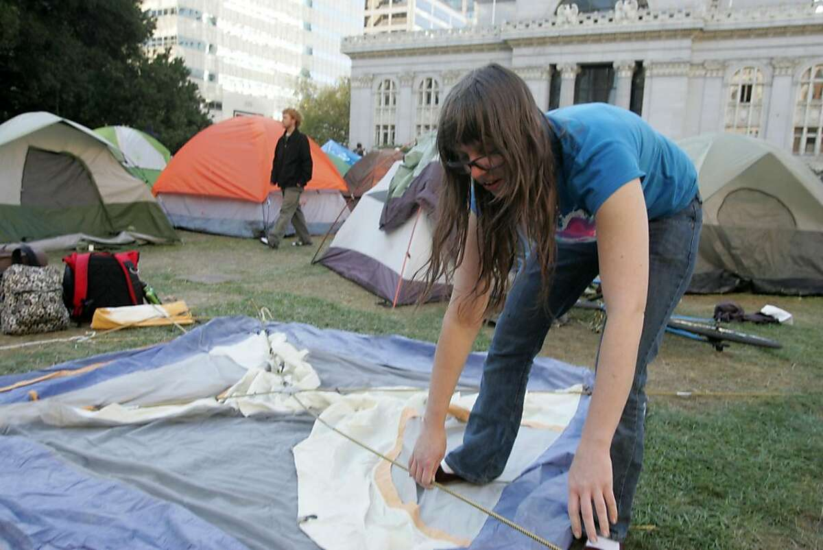 Wiljago Cook sets up her tent in Frank Ogawa Plaza as Occupy Oakland rebuilds on Friday, Oct. 28, 2011, in Oakland, Calif.