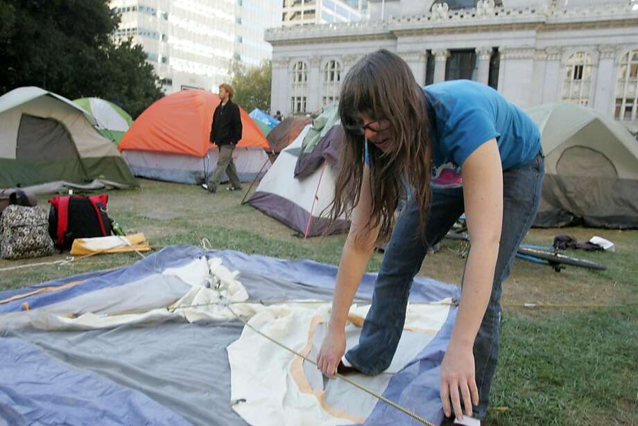 Wiljago Cook sets up her tent in Frank Ogawa Plaza as Occupy Oakland rebuilds on Friday, Oct. 28, 2011, in Oakland, Calif. Photo: Mathew Sumner, Special To The Chronicle
