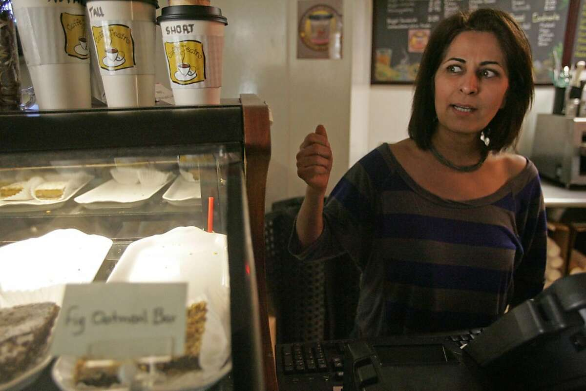 Moji Ghafouri, owner of Cafe Teatro near Frank Ogawa Plaza, talks about the affect of Occupy Oakland on her business on Friday, Oct. 28, 2011, in Oakland, Calif.