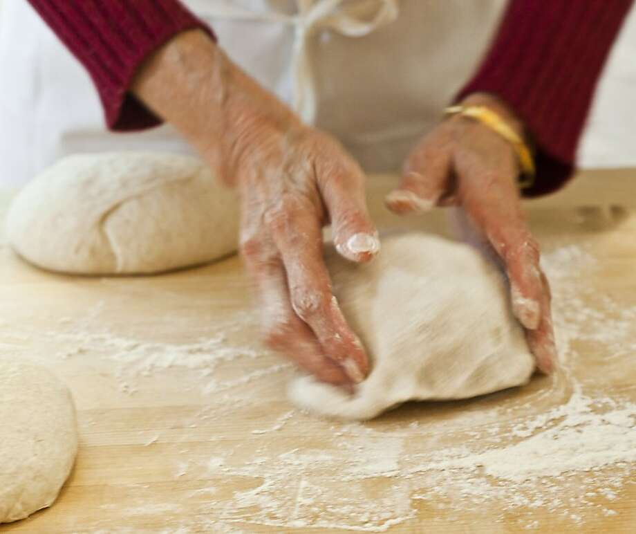 "Carol Field, author of, ""The Italian Baker,"" shapes dough for bread on Wednesday, Oct. 26, 2011 in San Francisco, Calif.  Field will release an updated version of the cookbook she first published in 1985. Photo: Russell Yip, The Chronicle"