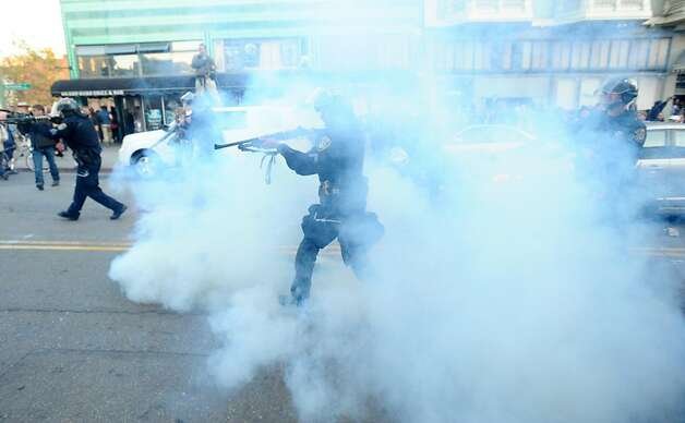 A police officer fires what appeares to be teargas at Occupy Oakland protesters on Tuesday, Oct. 25, 2011, in Oakland, Calif. Photo: Noah Berger, Special To The Chronicle