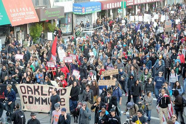 Occupy Oakland demonstrators march through Chinatown on Tuesday, Oct. 25, 2011, in Oakland, Calif. Photo: Noah Berger, Special To The Chronicle