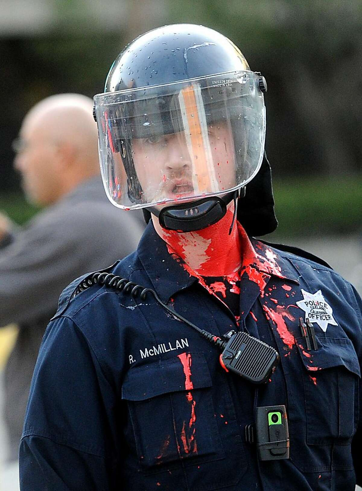 Red paint thrown by protesters coats officer McMillan during an Occupy Oakland demonstration on Tuesday, Oct. 25, 2011, in Oakland, Calif.