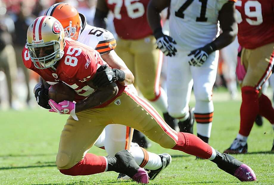 SAN FRANCISCO, CA - OCTOBER 30:  Vernon Davis #85 of the San Francisco 49ers gets tackled from behind by Chris Gocong #51 of the Cleveland Browns at Candlestick Park on October 30, 2011 in San Francisco, California.  (Photo by Thearon W. Henderson/Getty Images) Photo: Thearon W. Henderson, Getty Images