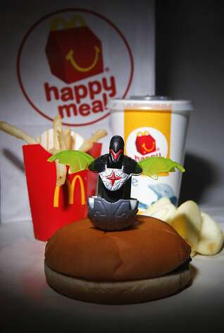 A McDonald's Happy Meal, purchased  on Tuesday, Nov. 29, 2011 in San Francisco, Calif., came with a free toy Ran on: 11-30-2011 The new rules on kids' meals go into effect Thursday. Ran on: 11-30-2011 The new rules on kids' meals go into effect Thursday. Photo: Russell Yip, The Chronicle