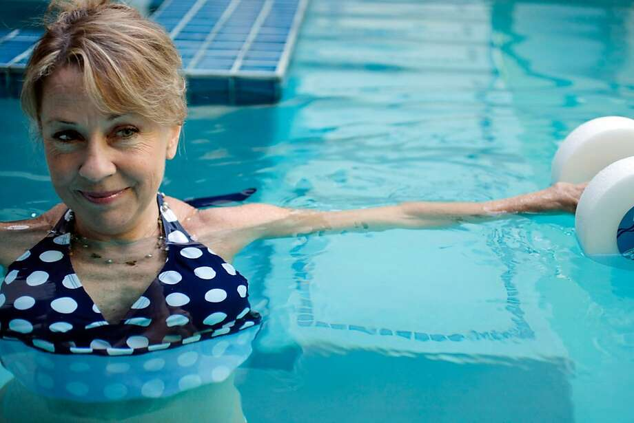 """Nora Delaney, who has been limited by arthritis her entire life, in her backyard pool in San Jose, Calif. on Friday, Oct. 7, 2011.  Nora and her husband designed the pool with 2"""" steps so she could get in and out easily for her morning workouts. Photo: Thomas Webb, The Chronicle"""
