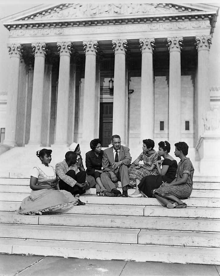 **ADVANCE FOR THURSDAY, FEB. 12** In this Aug. 22, 1958 file photo Thurgood Marshall, center, chief legal counsel of the National Association for the Advancement of Colored People, is surrounded by students and their escort from Little Rock, Ark., as he sits on the steps of the Supreme Court Building in Washington after he filed an appeal in the integration case of Little Rock's Central High School. The students are, from left: Melba Pattillo, Jefferson Thomas, Gloria Ray, escort Daisy Bates, Marshall, Carlotta Walls, Minnijean Brown, and Elizabeth Eckford. (AP Photo, file) Ran on: 02-12-2009 Thurgood Marshall (center) and students from Little Rock, Ark., sit on the steps of the Supreme Court in August 1958. Ran on: 02-12-2009 Thurgood Marshall (center) and students from Little Rock, Ark., sit on the steps of the Supreme Court in August 1958. Photo: AP