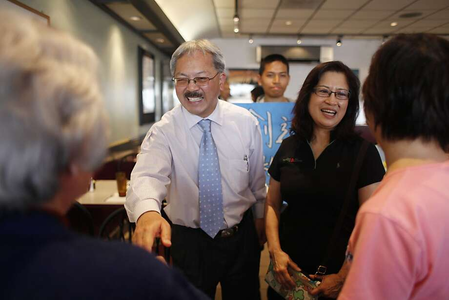 San Francisco Mayor Ed Lee (l to r) and his wife Anita Lee talk to diners at a restaurant while on a merchant walk on Noriega Street in San Francisco, Calif., on Friday, October 14, 2011. Photo: Lea Suzuki, The Chronicle