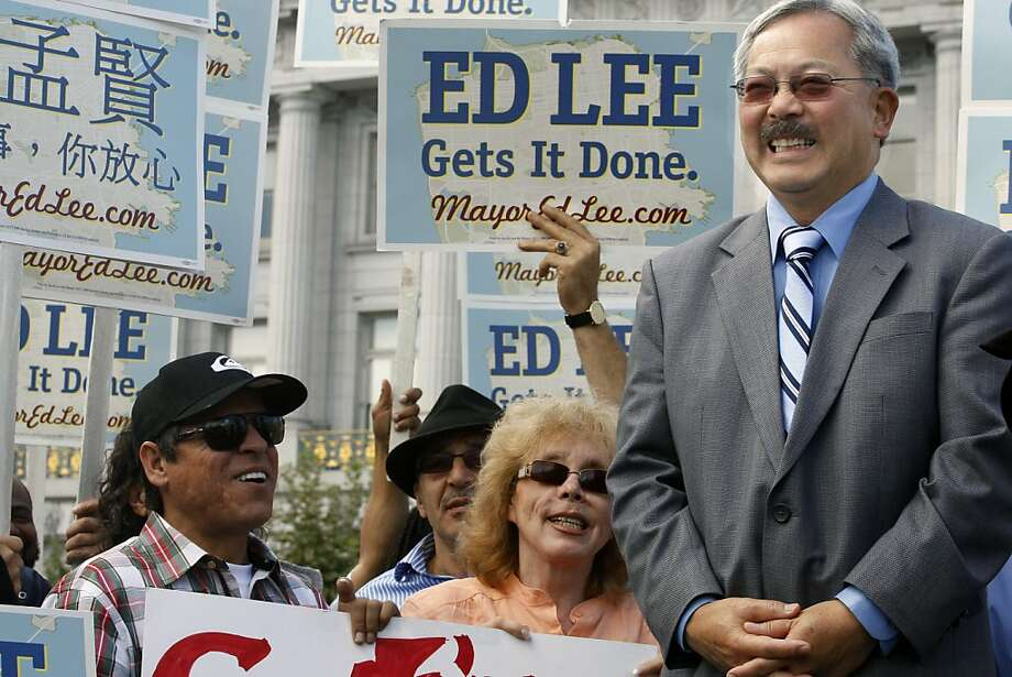 San Francisco mayor Ed Lee speaks to a large group outside City Hall prior to casting his early vote in the municipal election Tuesday October 11, 2011.   Ran on: 10-26-2011 Mayor Ed Lee says he welcomes investigation. Photo: Lance Iversen, The Chronicle