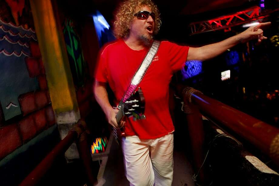 Sammy Hagar acknowledges the crowd as he walks to the stage to perform at the Cabo Wabo Cantina in Cabo San Lucas, Mexico, on Saturday, Feb. 19, 2011. Ran on: 03-20-2011 Sammy Hagar heads to the stage to play at Cabo Wabo Cantina, a club he helped found in Cabo San Lucas, Mexico. The rocker also started the premium Cabo Wabo Tequila label. Ran on: 03-20-2011 Sammy Hagar heads to the stage to play at Cabo Wabo Cantina, a club he helped found in Cabo San Lucas, Mexico. The rocker also started the premium Cabo Wabo Tequila label. Photo: Russell Yip, The Chronicle