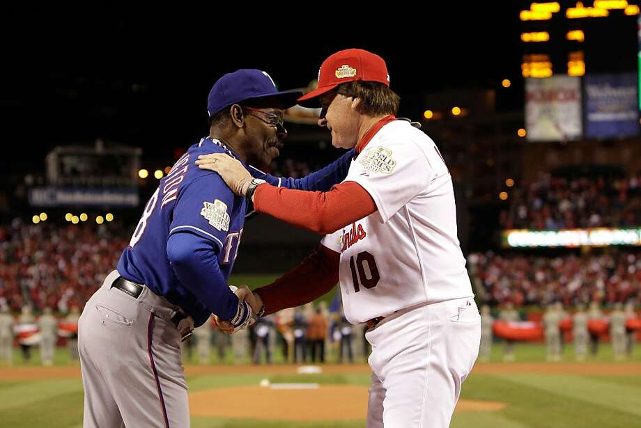 ST LOUIS, MO - OCTOBER 19:  (L-R) Manager Ron Washington #38 of the Texas Rangers and manager Tony La Russa #10 of the St. Louis Cardinals and shake hands prior to the start of Game One of the MLB World Series at Busch Stadium on October 19, 2011 in St Louis, Missouri.  (Photo by Paul Sancya-Pool/Getty Images) Photo: Pool, Getty Images