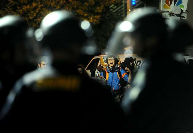 An Occupy Oakland protester yells at police officers after they cleared the city hall encampment on Tuesday, Oct. 25, 2011, in Oakland, Calif. Photo: Noah Berger, Special To The Chronicle
