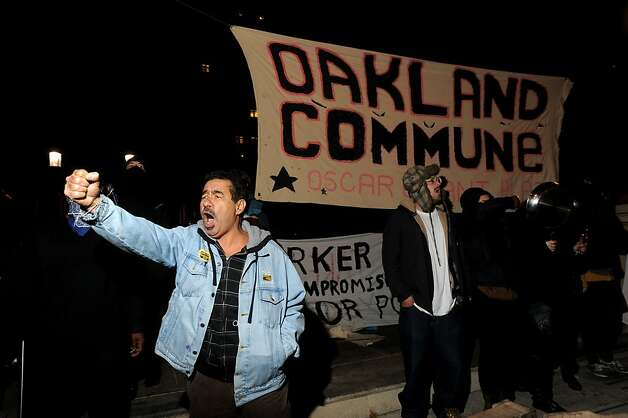 Occupy Oakland protesters yell as police approach their city hall encampment on Tuesday, Oct. 25, 2011, in Oakland, Calif. Photo: Noah Berger, Special To The Chronicle