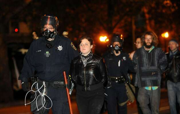 Police arrest an Occupy Oakland camper near city hall on Tuesday, Oct. 25, 2011, in Oakland, Calif. Photo: Noah Berger, Special To The Chronicle