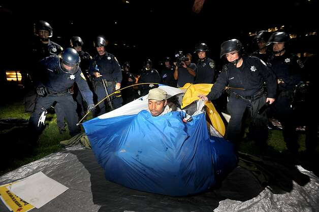 Police remove an Occupy Oakland camper from Snow Park on Tuesday, Oct. 25, 2011, in Oakland, Calif. Police descended on Occupy Oakland's two camps overnight flattening tents and arresting protesters. Photo: Noah Berger, Special To The Chronicle