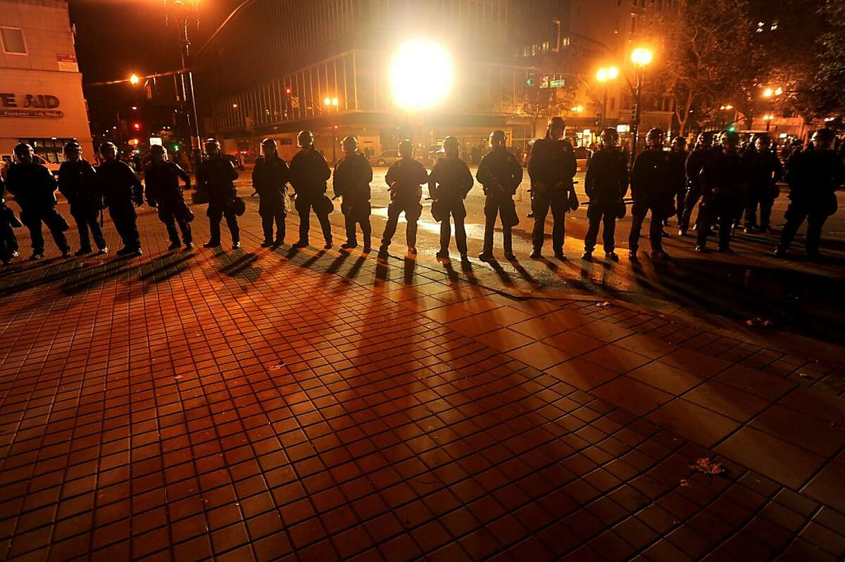 Clad in riot gear, police advance on Occupy Oakland's city hall encampment on Tuesday, Oct. 25, 2011, in Oakland, Calif.