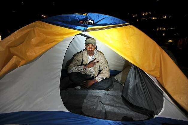 An Occupy Oakland protester waits in his tent as police clear the group's Snow Park encampment on Tuesday, Oct. 25, 2011, in Oakland, Calif. He was dragged from his tent and arrested shortly after this picture was taken. Photo: Noah Berger, Special To The Chronicle