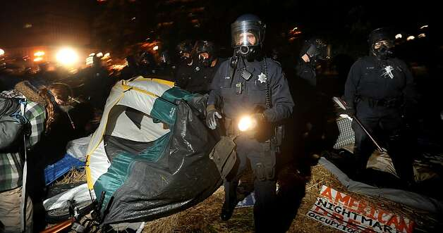 Clad in riot gear, police flatten Occupy Oakland's city hall encampment on Tuesday, Oct. 25, 2011, in Oakland, Calif. Photo: Noah Berger, Special To The Chronicle