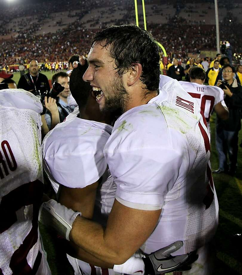 LOS ANGELES, CA - OCTOBER 29:  Quarterback Andrew Luck #12 of the Stanford Cardinal celebrates with teammates after the game with the USC Trojans at the Los Angeles Memorial Coliseum on October 29, 2011 in Los Angeles, California. Stanford won 56-48 in three overtimes.  (Photo by Stephen Dunn/Getty Images) Photo: Stephen Dunn, Getty Images