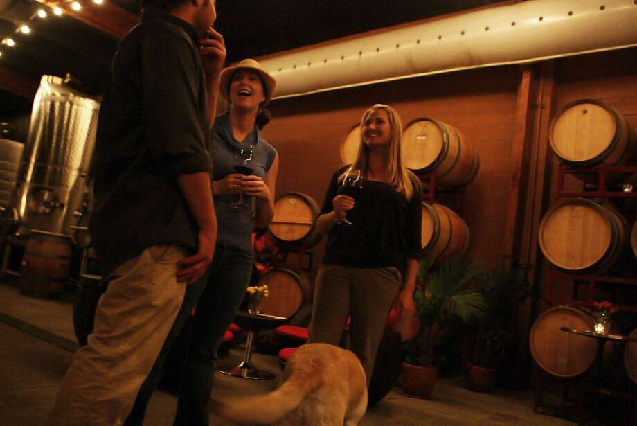 From left to right, Tim Nuss, Megan Flood, and Amanda Collinson at Vinoce Winery in Napa, Calif., on Tuesday, Oct. 18, 2011.  Tim's father Brian owns and operates Vinoce, which has the only crush facility in downtown Napa. Photo: Dylan Entelis, The Chronicle