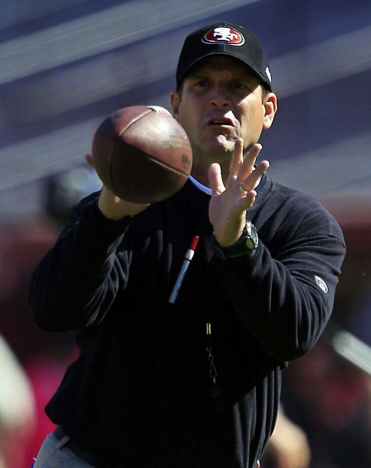 San Francisco 49ers head coach Jim Harbaugh catches the ball as his team warms up before their NFL football game against the Cleveland Browns in San Francisco, Sunday, Oct. 30, 2011.  (AP Photo/Marcio Jose Sanchez) Photo: Marcio Jose Sanchez, AP