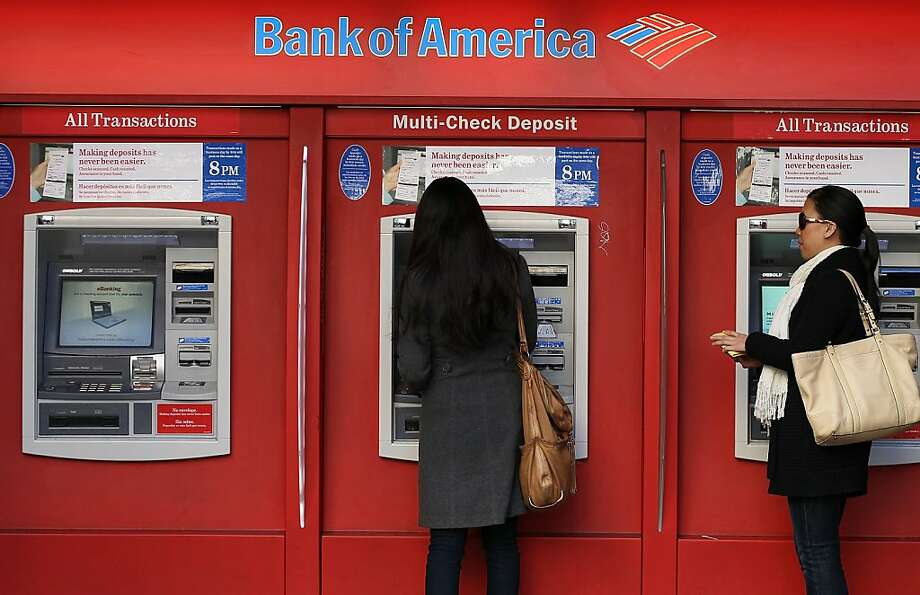 SAN FRANCISCO, CA - FILE:   People use a Bank of America  ATM  on January 21, 2011 in San Francisco, California. According to reports June 28, 2011, Bank of America reached a settlement in which it will pay $8.5 billion to 530 private trusts who said the bank violated mortgage obligations that were issued by Countrywide Financial, at one point the largest housing lender in the U.S., who was subsequently bought by Bank of America during the financial crisis.  (Photo by Justin Sullivan/Getty Images)  Ran on: 06-30-2011 Bank of America's settlement stems from its 2008 purchase of Countrywide Financial Corp., which packaged home loans into bonds that soured. Photo: Justin Sullivan, Getty Images
