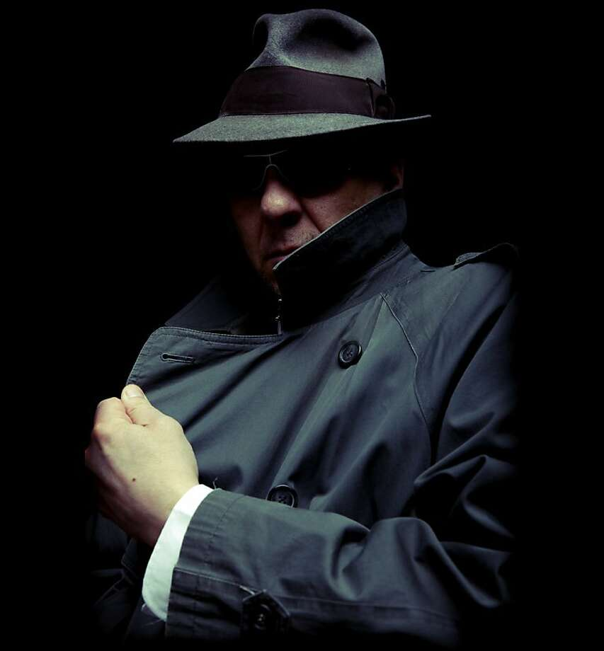 sinister looking gangster hiding his face. Photo: The Power Of Forever Photography, IStockphoto.com