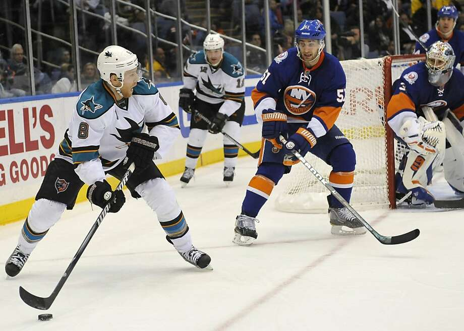 San Jose Sharks' Joe Pavelski (8) drives the puck around New York Islanders' Frans Nielsen (51), of Denmark, as Islanders goalie Rick DiPietro (39) looks on during the third period of an NHL hockey game on Saturday, Oct. 29, 2011, in Uniondale, N.Y. Pavelski scored in the first period during the Sharks 3-2 overtime win. (AP Photo/Kathy Kmonicek) Photo: Kathy Kmonicek, AP