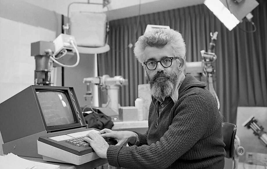 In this March 7, 1974 photo provided by the Stanford news Service, John McCarthy, professor of computer science, works at the artificial intelligence lab in Stanford, Calif. McCarthy, a pioneer in the field of artificial intelligence and professor emeritus at Stanford University, has died at age 84. The university announced that McCarthy died early Monday, Oct. 24, 2011, at his home in Palo Alto, Calif. (AP Photo/Stanford News Service, Chuck Painter) Ran on: 10-29-2011 John McCarthy's work on artificial intelligence in Stanford University's lab paved the way for the widespread use of robotics on factories' assembly lines and spacecrafts' planet exploration. Photo: Chuck Painter, AP