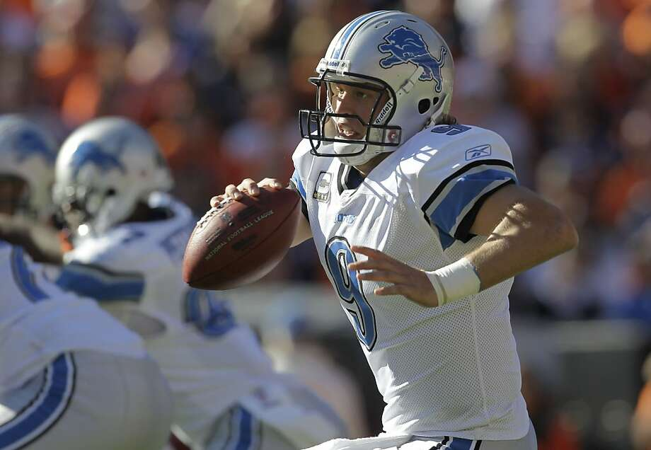 Detroit Lions quarterback Matthew Stafford (9) moves out of the pocket against the Denver Broncos during the first quarter of an NFL football game, Sunday, Oct. 30, 2011, in Denver.  (AP Photo/Joe Mahoney) Photo: Joe Mahoney, AP