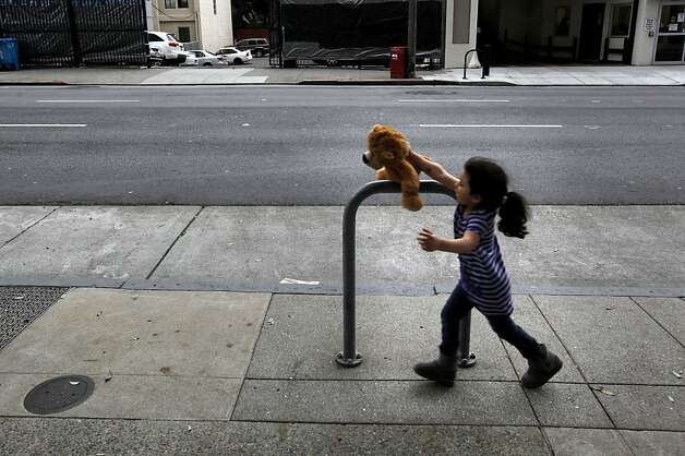 5-year-old Sofia Ayala plays with her stuffed animal, in San Francisco, Ca., on Wednesday November 23, 2011. Her single mother Celia Colon, has been homeless for the past year, her 5-year-old is one of 2,200 homeless kids in San Francisco schools. Ran on: 11-30-2011 Sofia Ayala, 5, playing with her stuffed animal on a street in San Francisco, is among the growing number of homeless children in the city. Sofia's single mother, Celia Colon, has been homeless for the past year, but recently landed a room at a shelter. Ran on: 11-30-2011 Sofia Ayala, 5, playing with her stuffed animal on a street in San Francisco, is among the growing number of homeless children in the city. Sofia's single mother, Celia Colon, has been homeless for the past year, but recently landed a room at a shelter. Photo: Michael Macor, The Chronicle