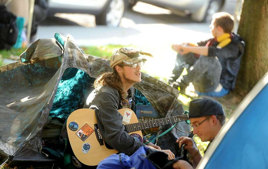 Occupy Berkeley protester Johnny Fish plays guitar outside his tent on Tuesday, Nov. 1, 2011, in Berkeley, Calif. As of Tuesday, about 30 tents dotted Civic Center Park. Photo: Noah Berger, Special To The Chronicle