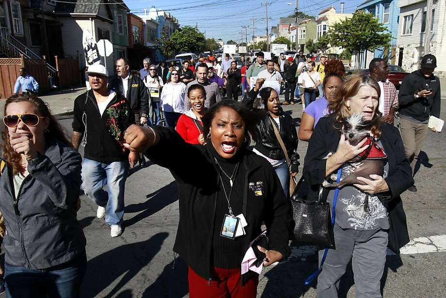 People marched down Quesada Avenue to protest the numerous foreclosures in the neighborhood. Bayview district families in San Francisco, Calif. at risk of losing their homes due to foreclosures announced they are refusing to leave Tuesday November 1, 2011 and held a demonstration on Quesada Avenue. Photo: Brant Ward, The Chronicle