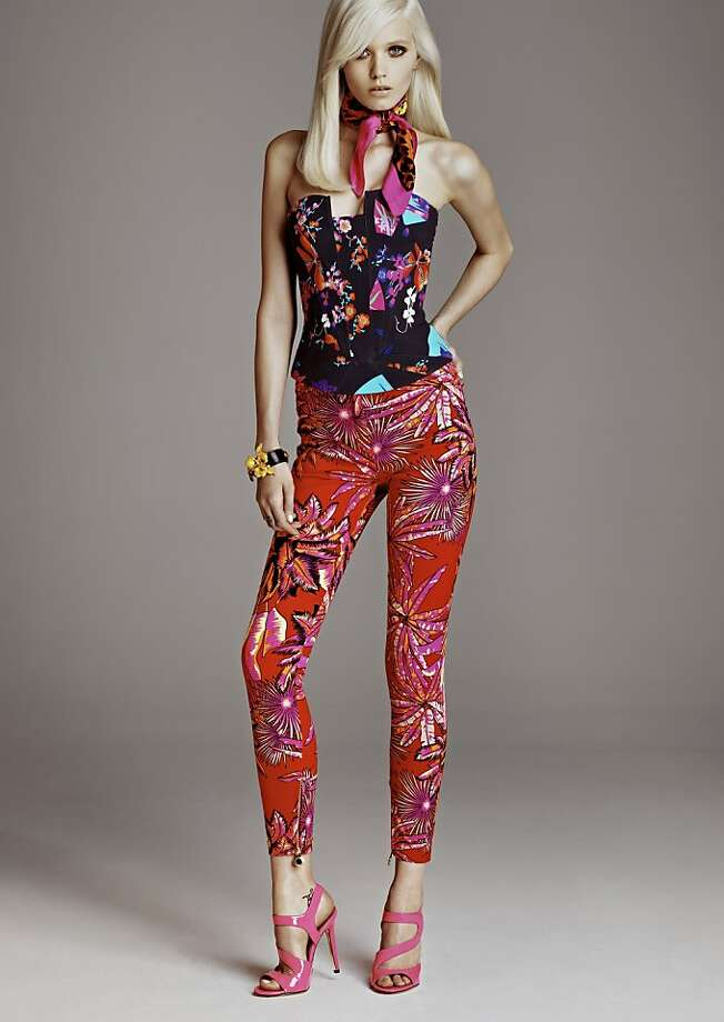 A women's look for Versace for H&M collection includes a silk bustier ($129) and pants ($69.95). Photo: H&m