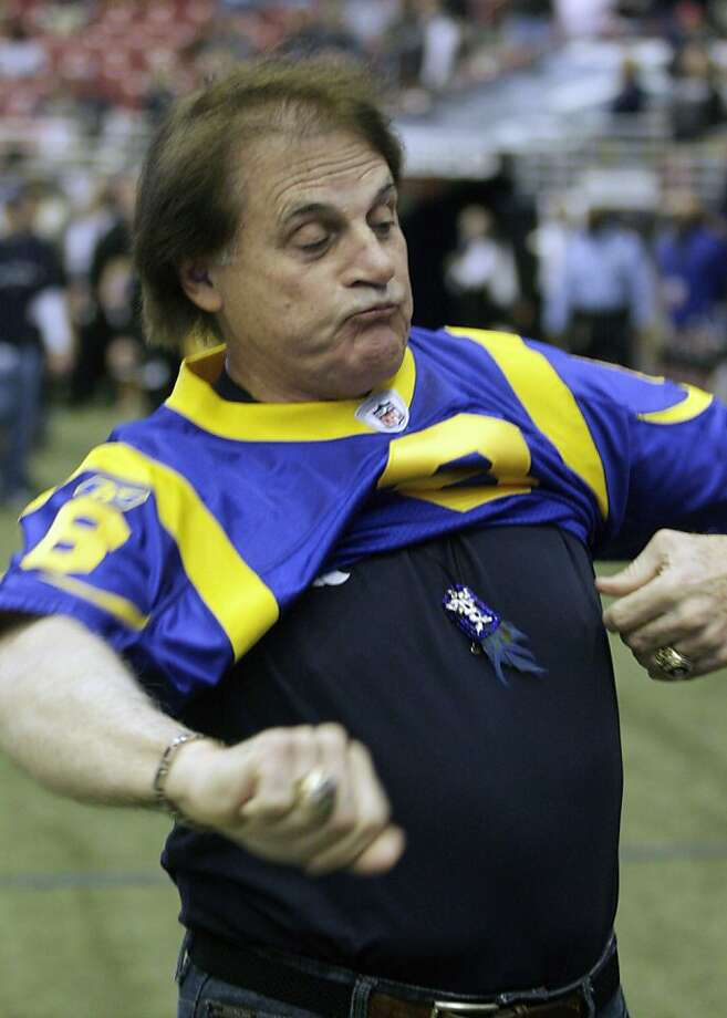St. Louis Cardinals baseball manager Tony La Russa puts on a St. Louis Rams jersey before the start of an NFL football game between New Orleans Saints and the Rams Sunday, Oct. 30, 2011, in St. Louis. (AP Photo/Tom Gannam)  Ran on: 10-31-2011 Cardinals manager Tony La Russa pulls on a Sam Bradford jersey before the Rams' game in St. Louis. Ran on: 10-31-2011 Cardinals manager Tony La Russa pulls on a Sam Bradford jersey before the Rams' game in St. Louis. Photo: Tom Gannam, AP