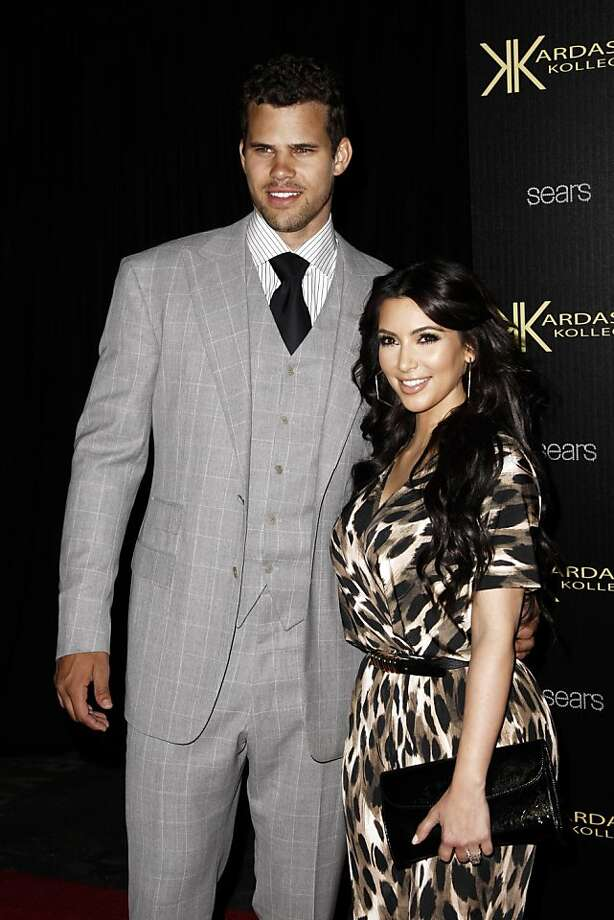 FILE - In this Aug. 17, 2011 file photo, reality TV personality Kim Kardashian, right, and her fiance, NBA basketball player Kris Humphries, arrive at the Kardashian Kollection launch party in Los Angeles.  Kardashian and Humphries are expected to wed on Saturday, Aug. 20, 2011 in Montecito, Calif. (AP Photo/Matt Sayles, file) Ran on: 08-21-2011 Kris Humphries and Kim Kardashian began dating late last year. Photo: Matt Sayles, AP