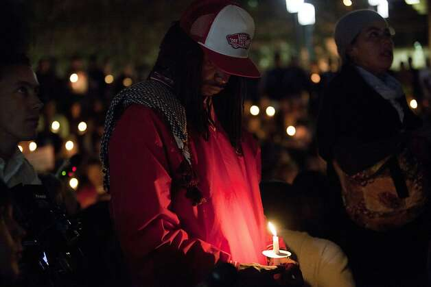 Alex Brown, of Oakland, holds a candle during a vigil for Scott Olsen, the Iraq War veteran who was injured in Tuesday's protest, outside of Oakland City Hall at the Occupy Oakland camp in Frank Ogawa on Thursday, October 27, 2011 in Oakland, Calif. Photo: Beck Diefenbach, Special To The Chronicle
