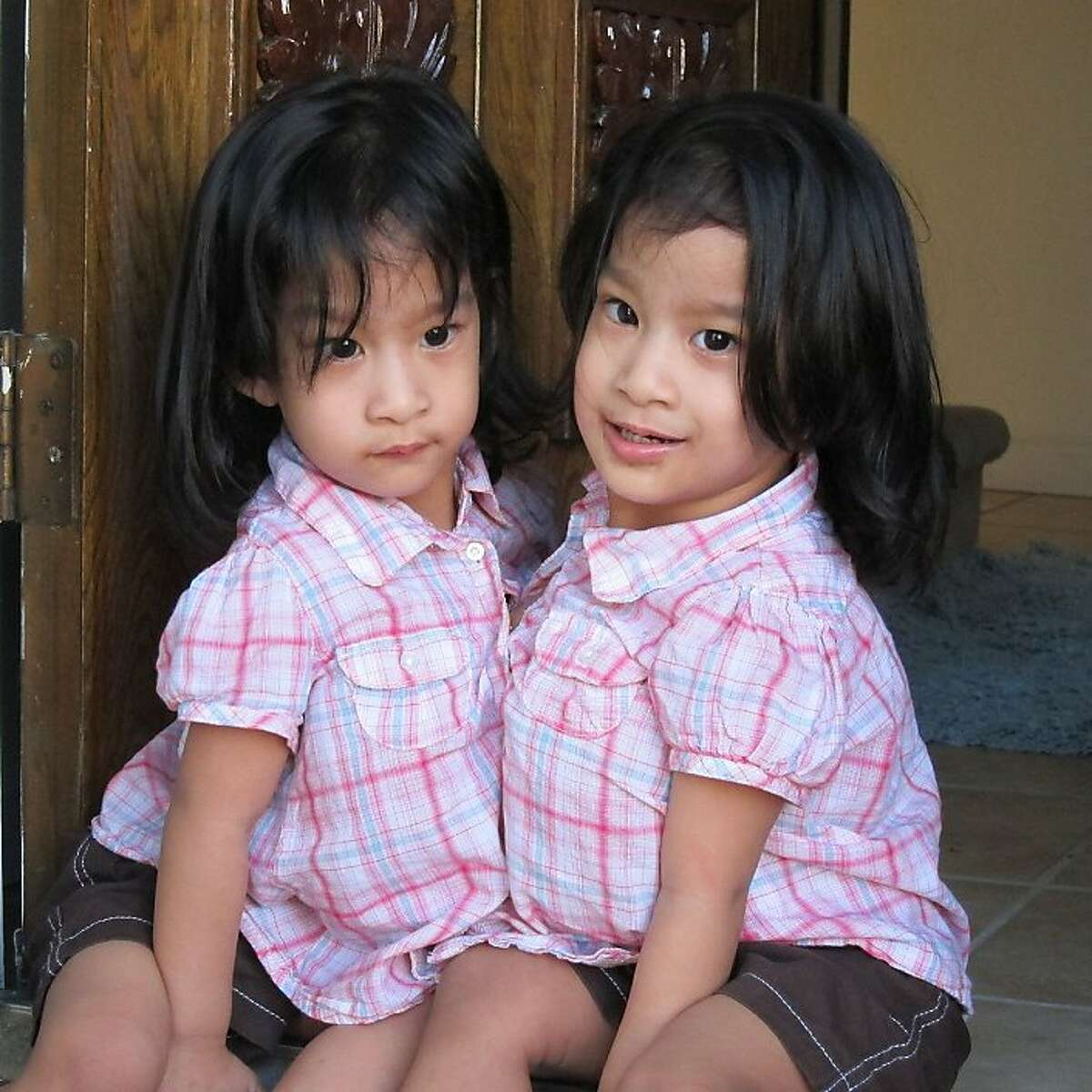 Angelina and Angelica Sabuco at home in San Jose, Calif. The cojoined twins are to be separated at Lucile Packard Hospital.