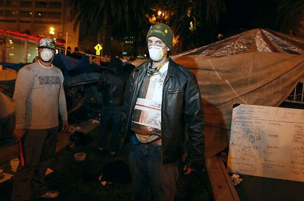 A protester fits himself in makeshift riot armor at the Occupy SF camp on Embarcadero Street in San Francisco, Calif. Oct. 26, 2011. Photo: Tim Maloney, The Chronicle