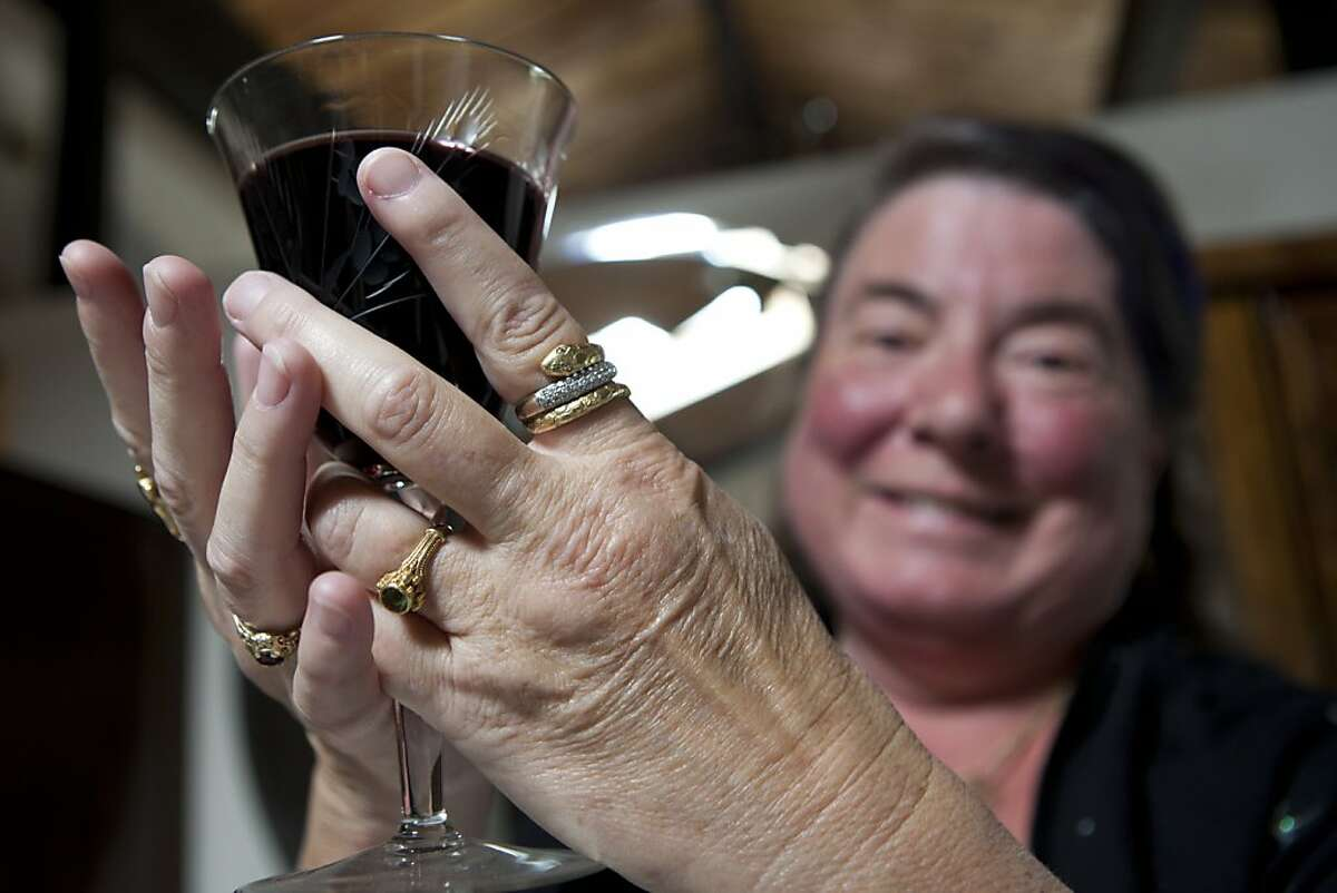 Wiccan Priestess Linnea Dunn displays a glass of wine used during the Wiccan ritual of Feri in the temple inside her home on Tuesday, September 27, 2011 in Santa Cruz, Calif. Dunn has been a Wiccan priestess for 34 years.